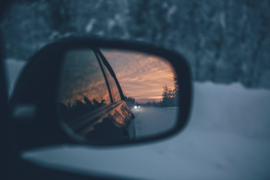 Rearview mirror reflecting sunset